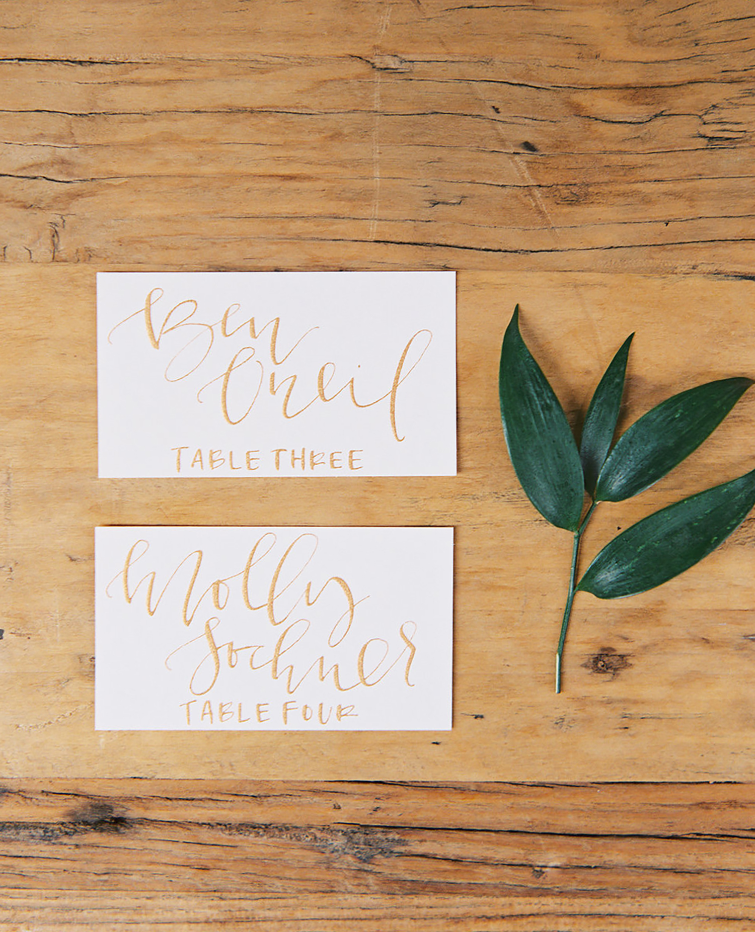 Gold calligraphy escort cards   A FAbulous Fete