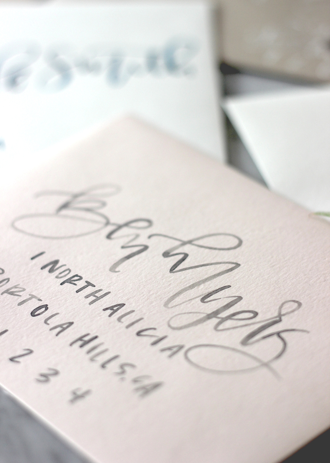 Textured blush envelope with grey watercolor addressing | A Fabulous Fete
