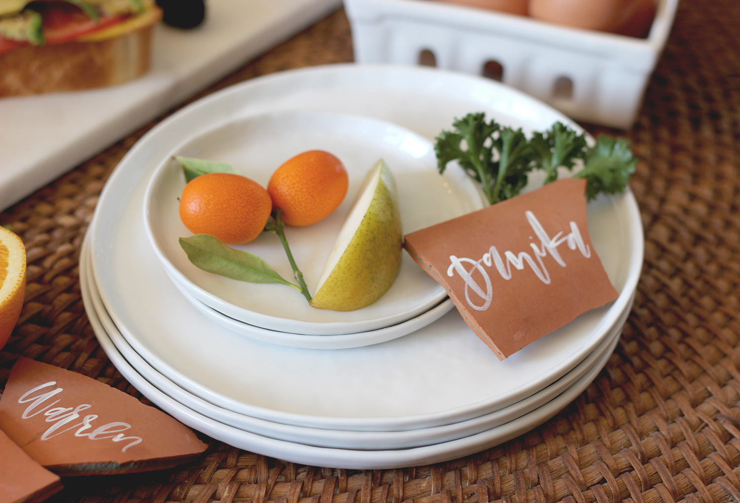 Set the table at brunch with simple white plates and terra cotta accets | A Fabulous Fete