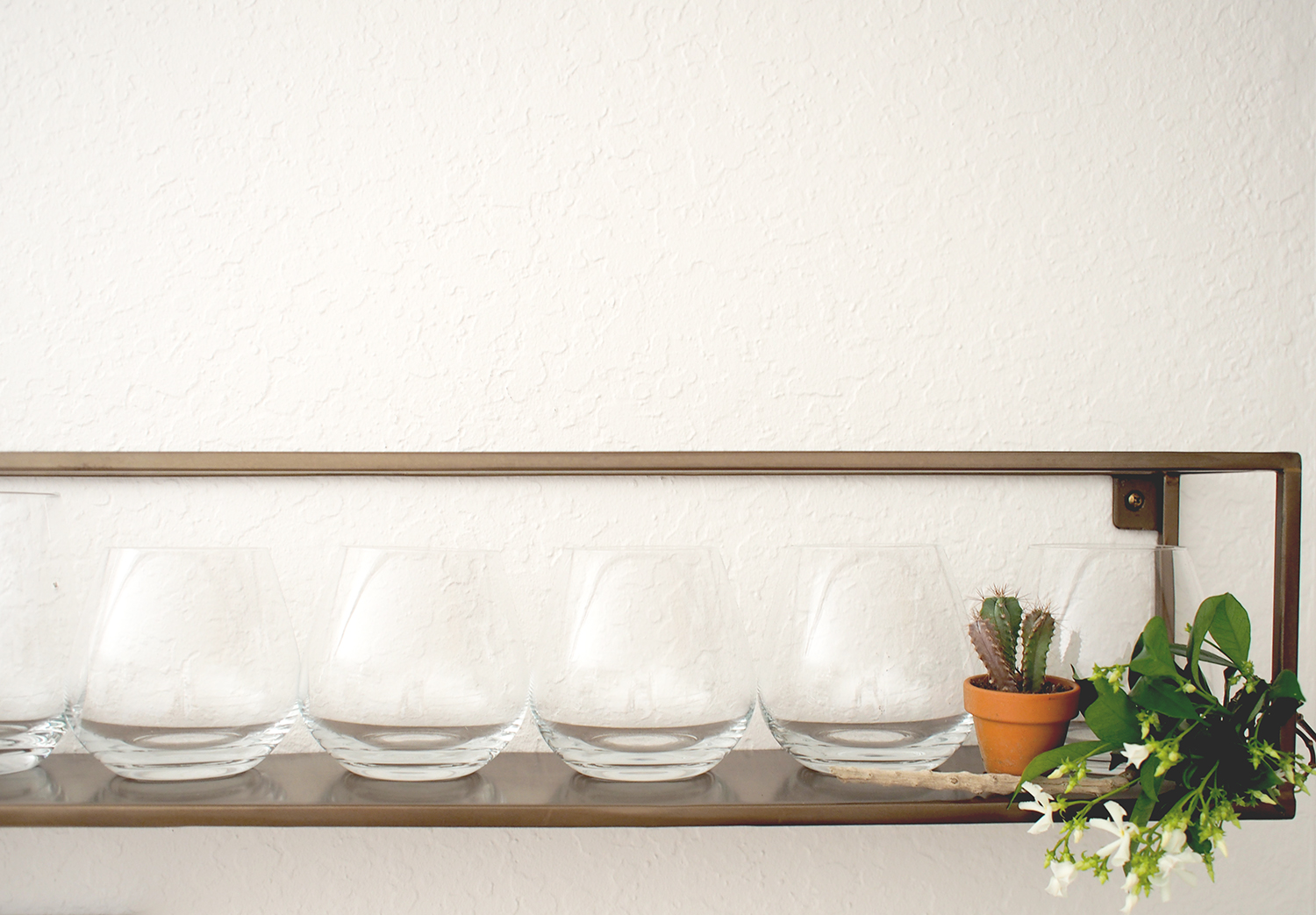 This long skinny shelves is perfect for housing your wine glasses | A Fabulous Fete