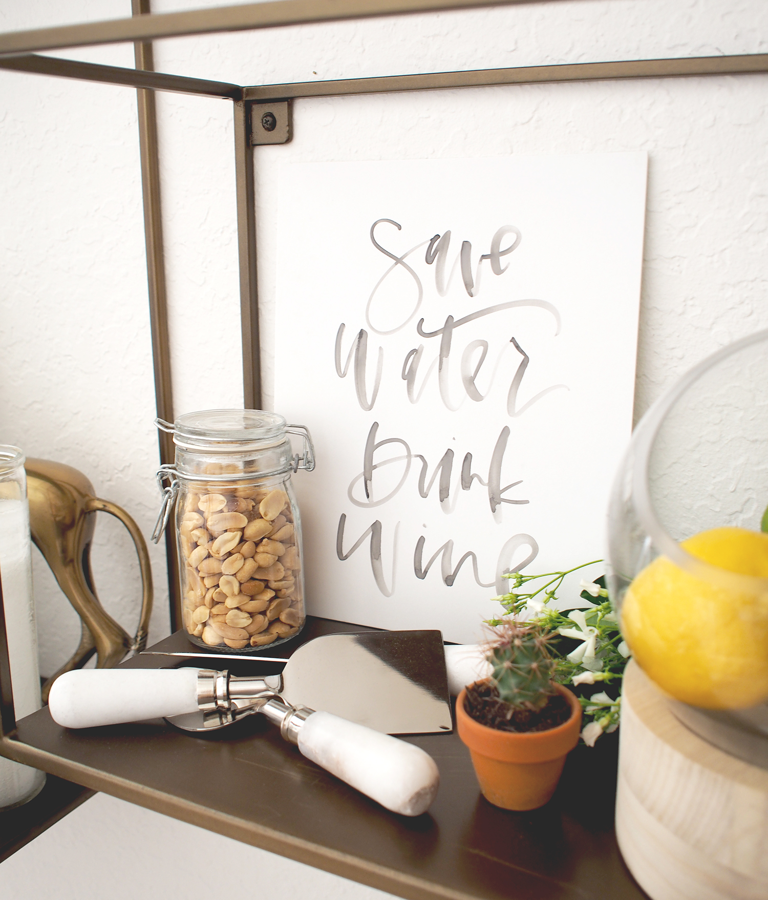 Always add a little art or a fun quote on your shelves to take up some of the empty wall space and add color + interest | A Fabulous Fete