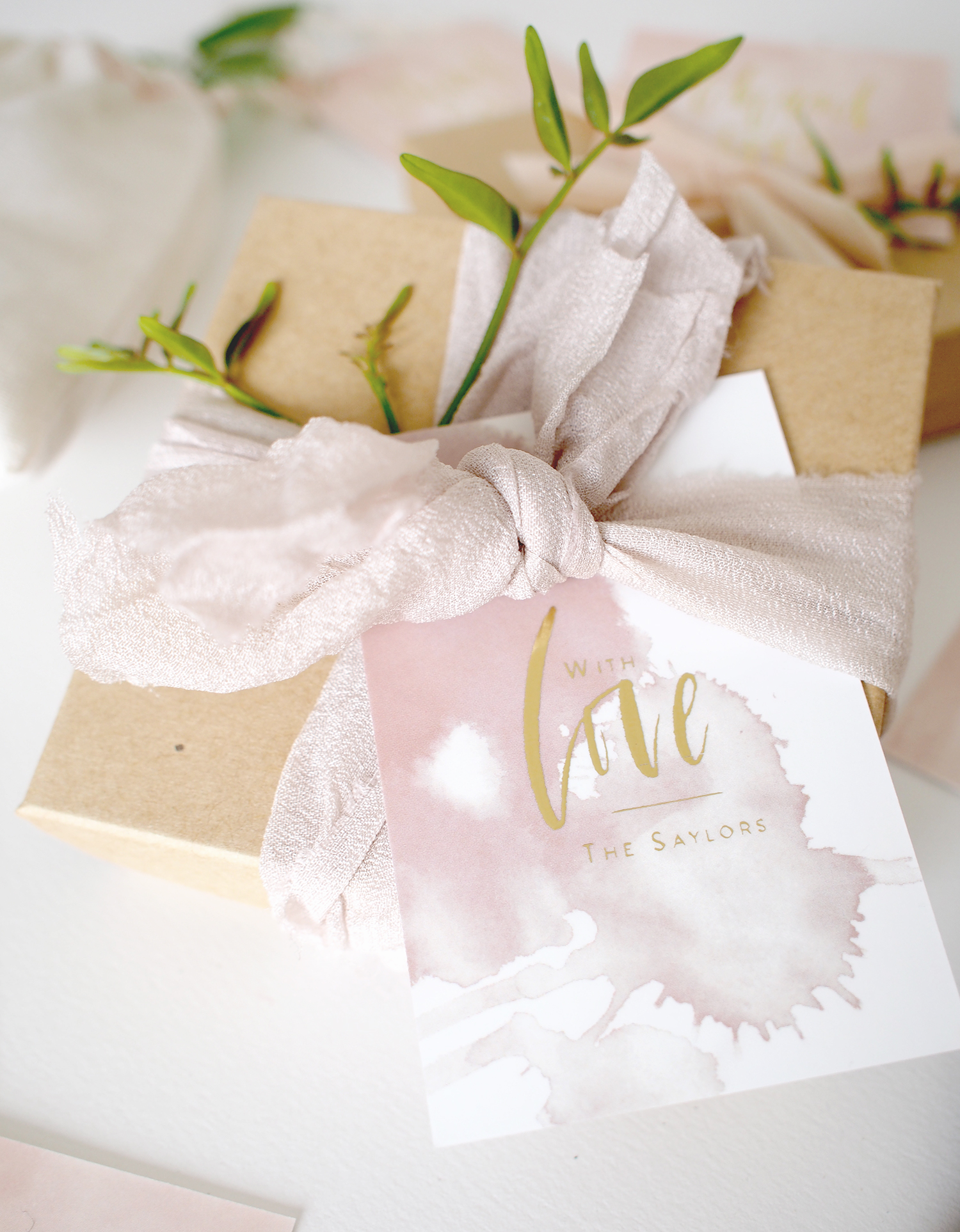Simple wrapping for gifts or favors with custom gold foil tags, ribbon and a fresh clipping   A Fabulous Fete