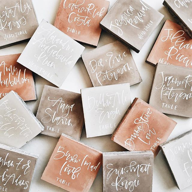 Cement tiles with hand lettering for escort cards | A Fabulous Fete