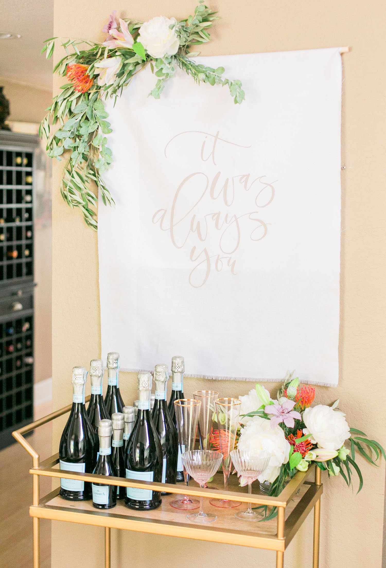 Stocked bar with fabric signage for a special occasion | A Fabulous Fete