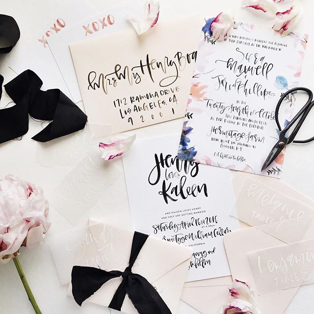 Black and white wedding invitations and colorful floral borders | A Fabulous Fete