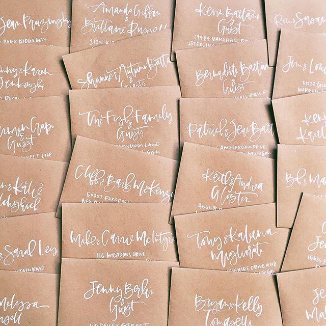 White and kraft wedding invitation envelopes | A Fabulous Fete