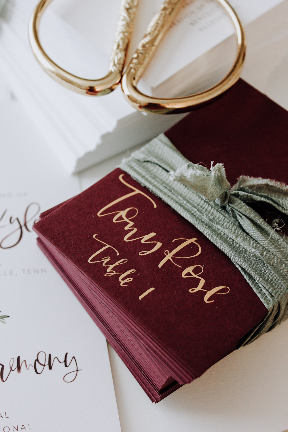 Wine escort cards with gold calligraphy | A Fabulous Fete