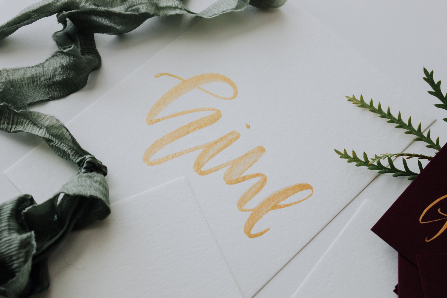 Gold watercolor hand lettered table numbers | A Fabulous Fete