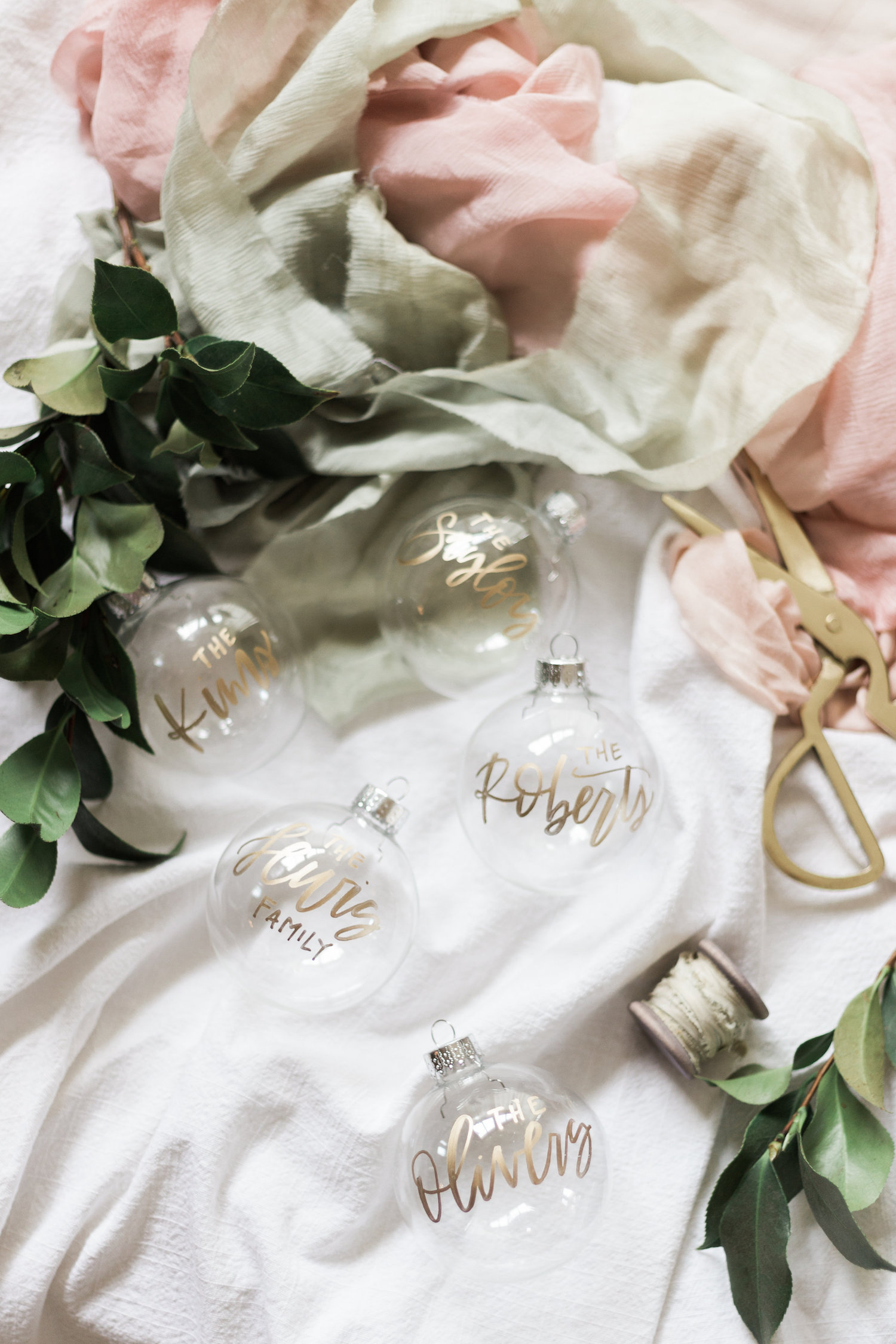 Gold hand lettered christmas ornaments in the shop | A Fabulous Fete