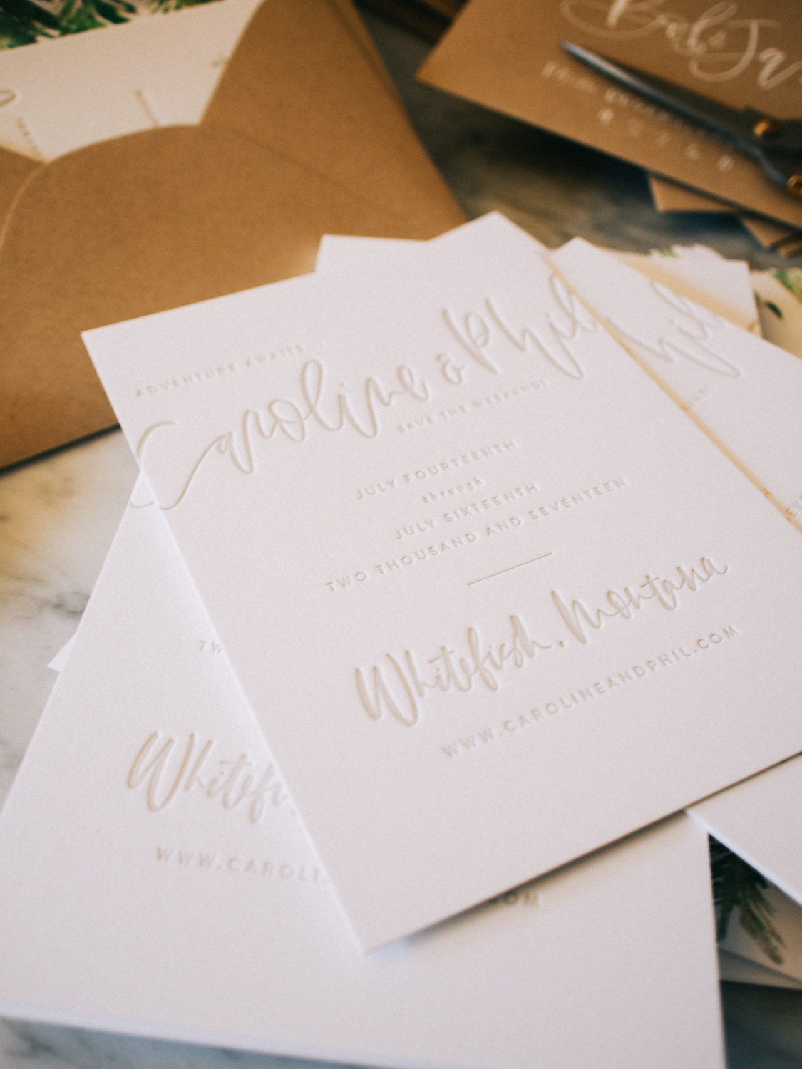 Taupe letterpress wedding save the dates with kraft and white envelopes   A Fabulous Fete