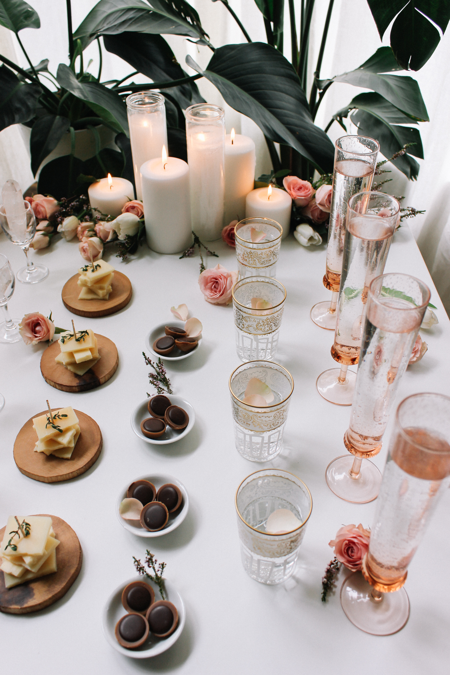 Add a few of your houseplants behind a simple table to create an instant backdrop for any snack or cocktail bar | A Fabulous Fete