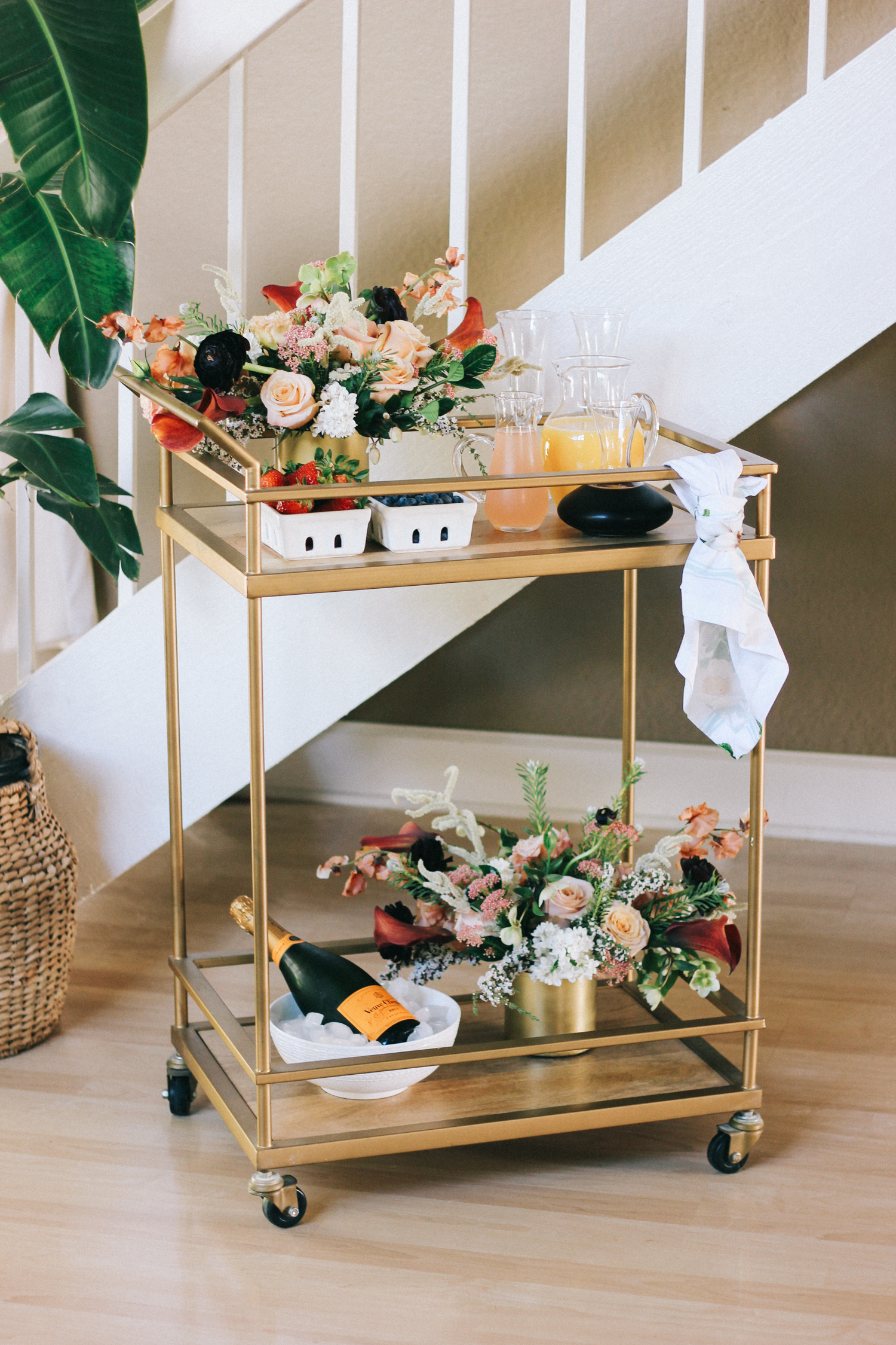 Spring bar cart with a mimosa and fruit bar | A Fabulous Fete