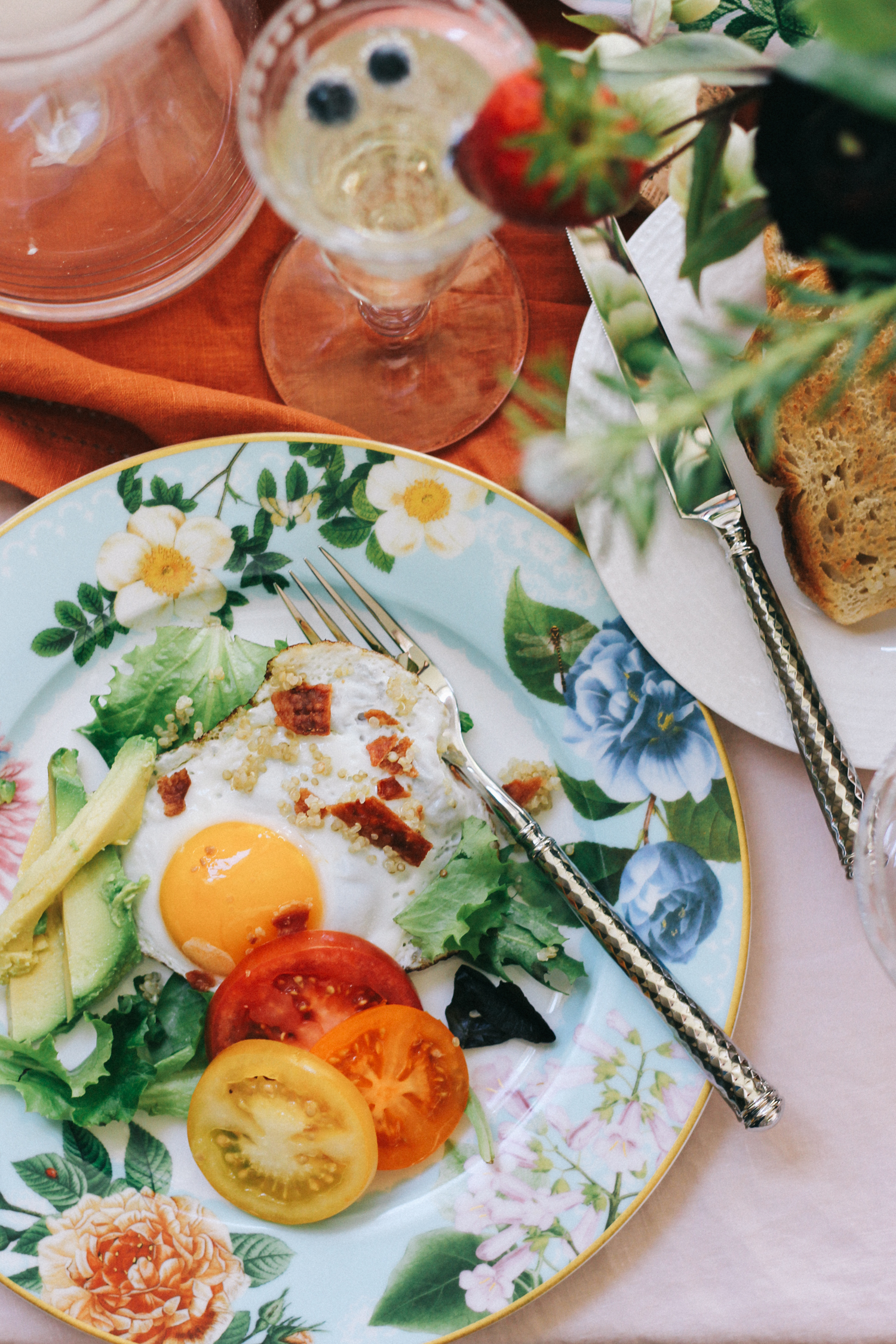 Breakfast salad made with quinoa, bacon, tomatoes, avocado and eggs over-easy | A Fabulous Fete