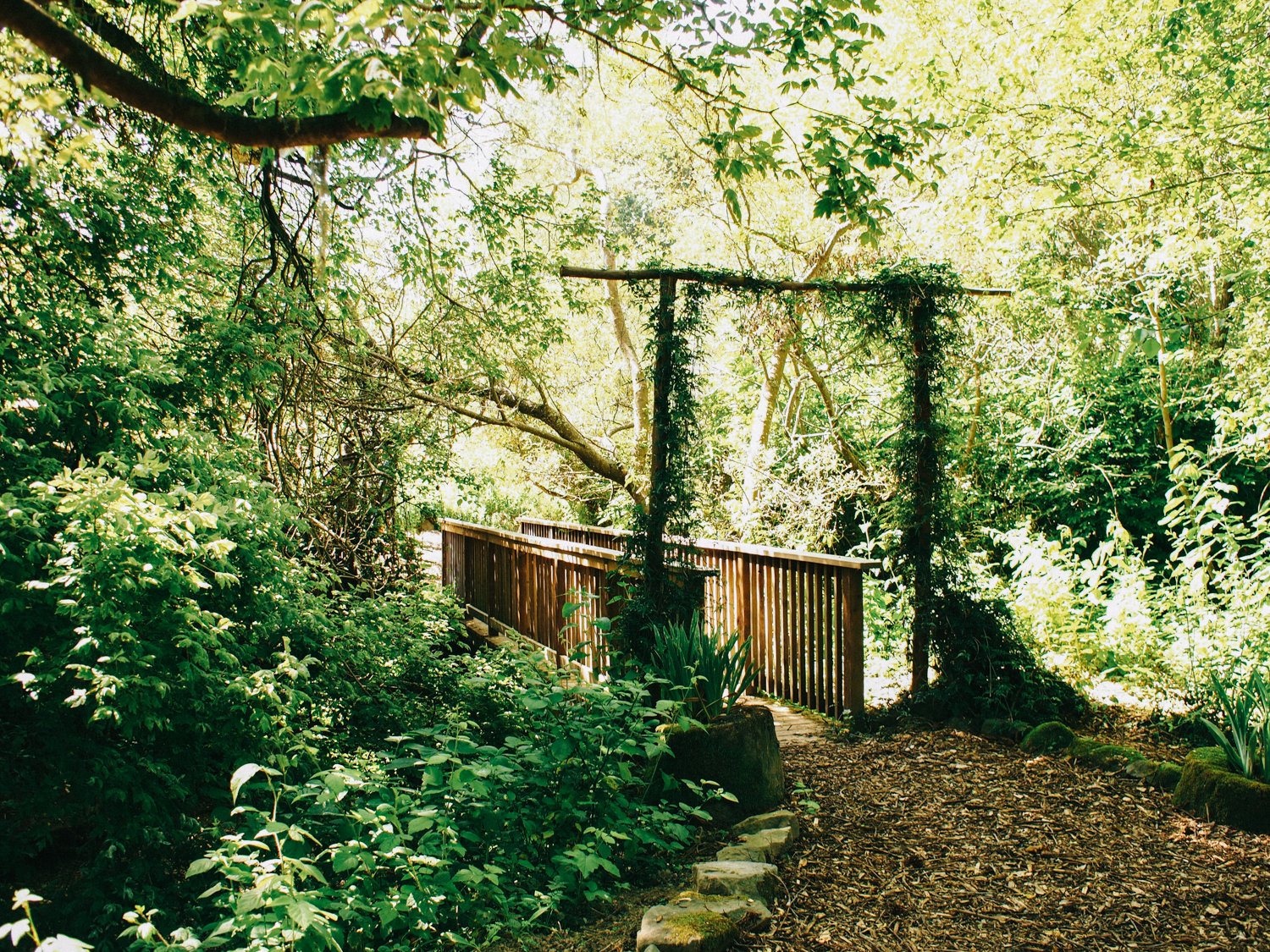 Secret garden in Half Moon Bay, this bridge let to flower fields with a small wedding venue | A Fabulous Fete