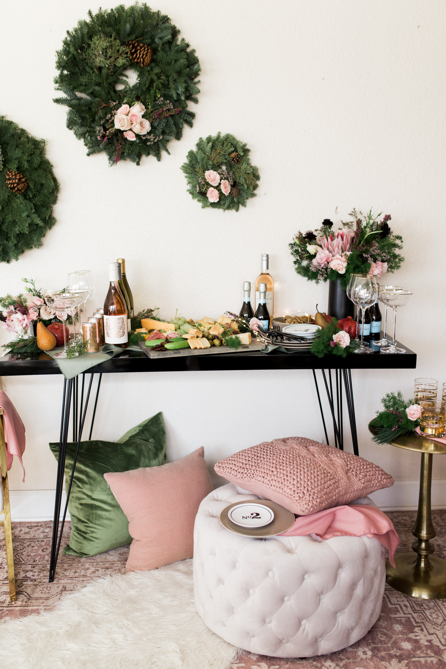 Create this easy backdrop with a few wreaths and some flowers! | A Fabulous Fete