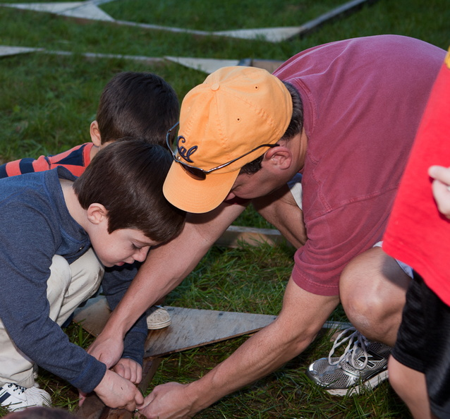 father and son building sukkah.jpg
