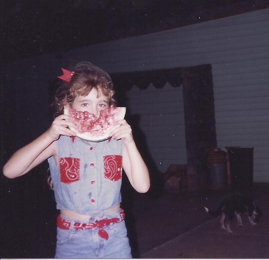 Enjoying some fresh slices of watermelon as a kiddo.