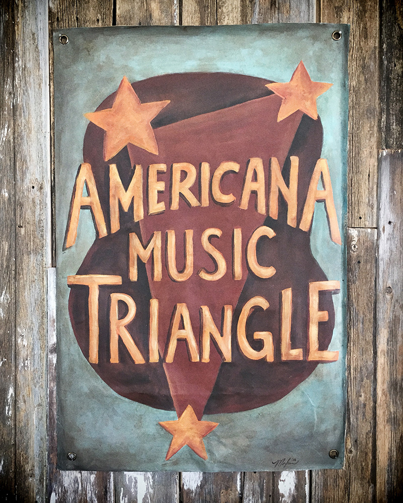 Hand painted poster for the Americana Music Triangle on stage at the Pilgrimage Festival 2018