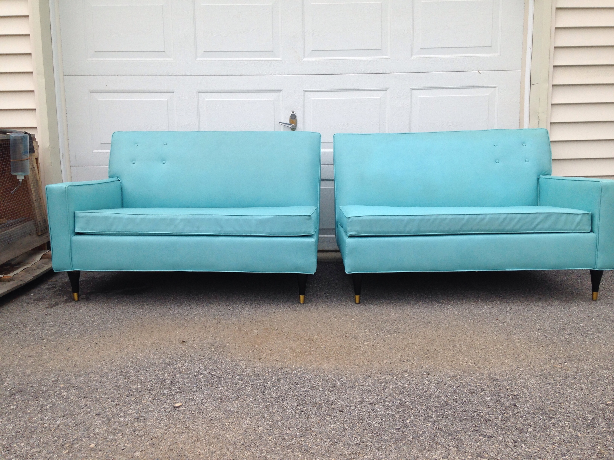 2 love seat sized settee's make up this versatile seating set that can be arranged to create a fabulous nook area. Great Aqua color features black plastic legs with gold trim.  Very comfy!