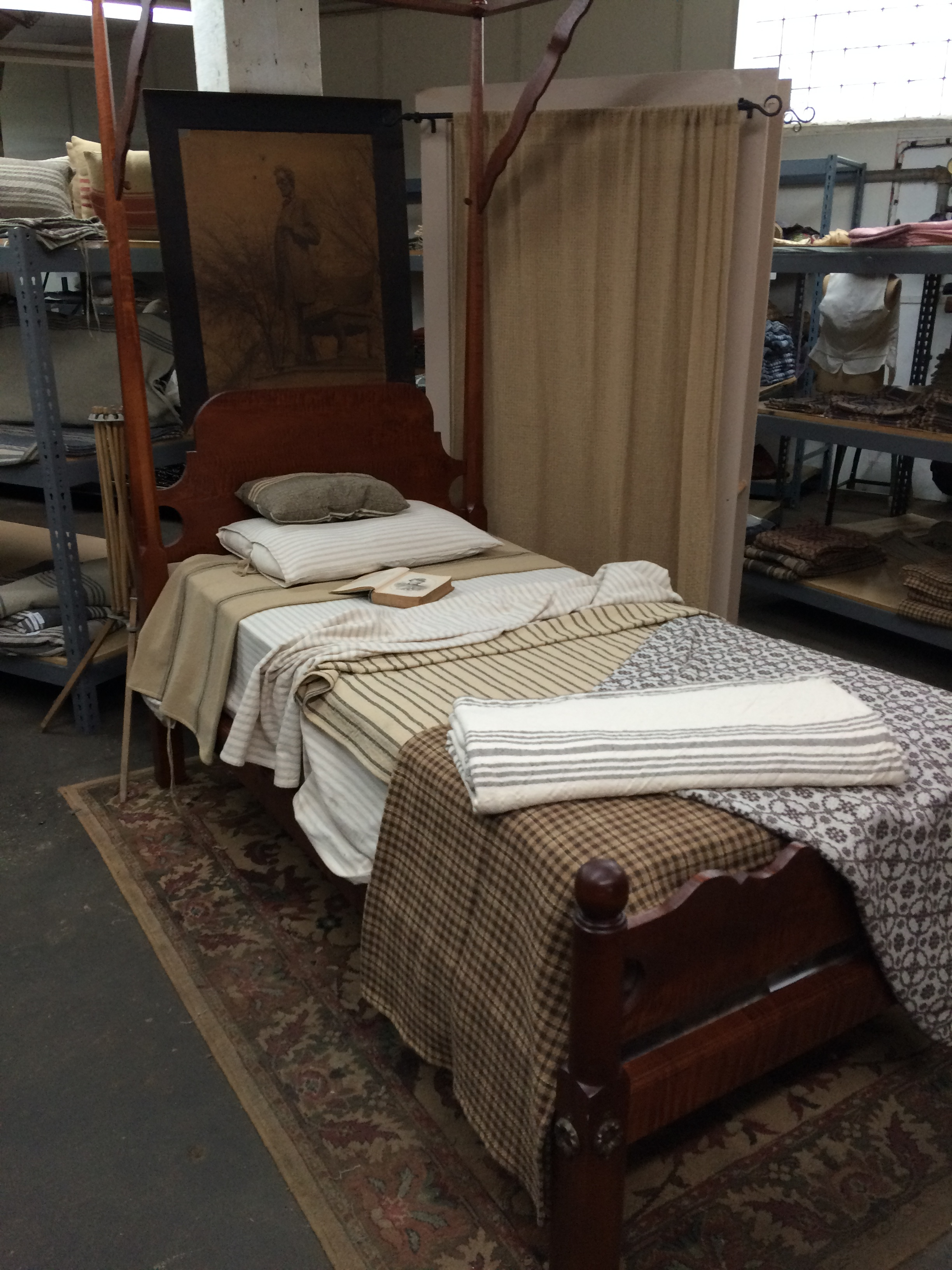 A display of some of the more traditional offerings. There are pillows, throws, bedspreads and more being woven here!