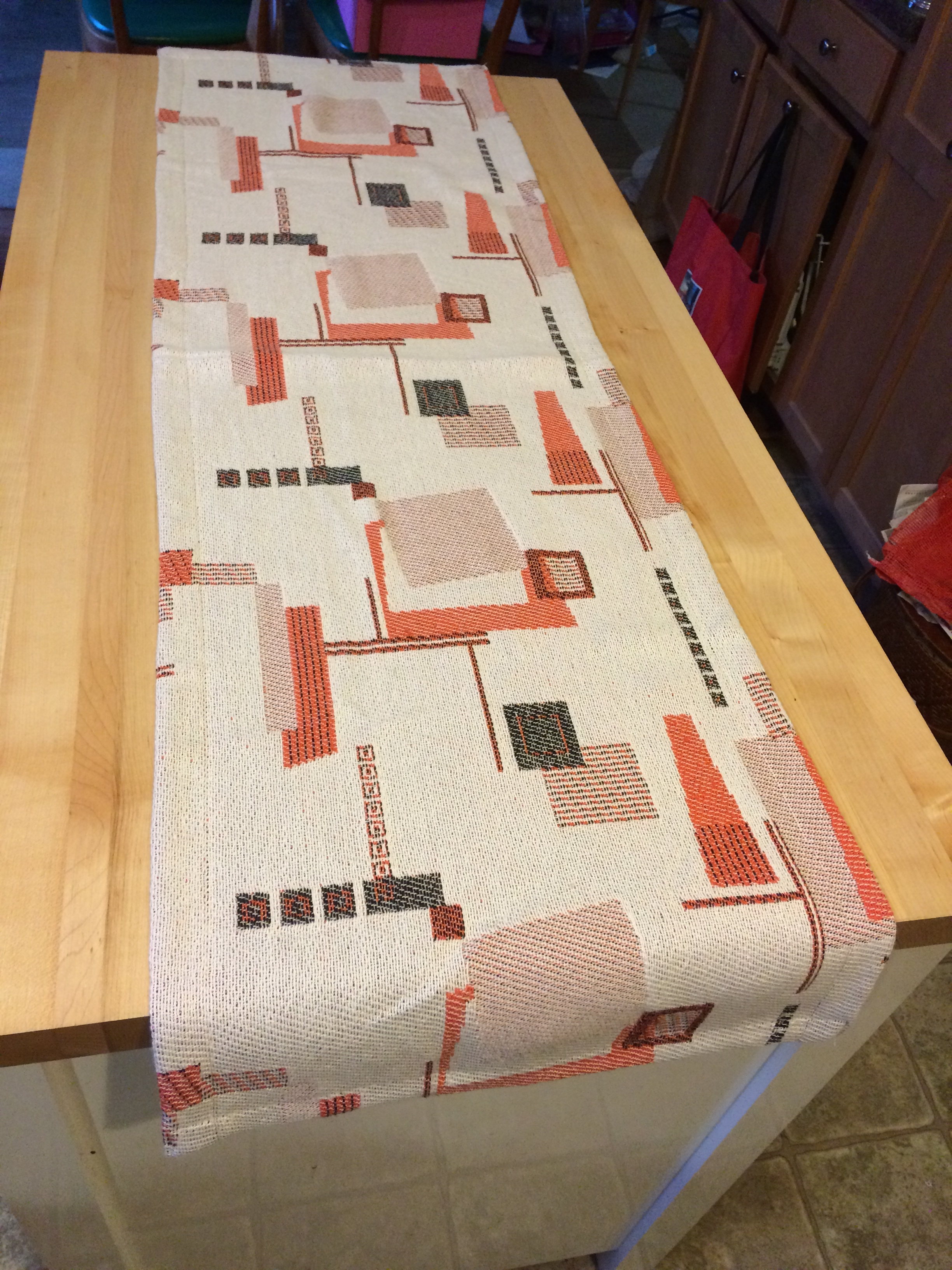 Same orange and coordinating threads as the clocks in this great Atomic geometric design.  This runner is same construction as the clocks including an upgraded bound hem. Also $25 plus ship. https://www.ebay.com/itm/322359478602
