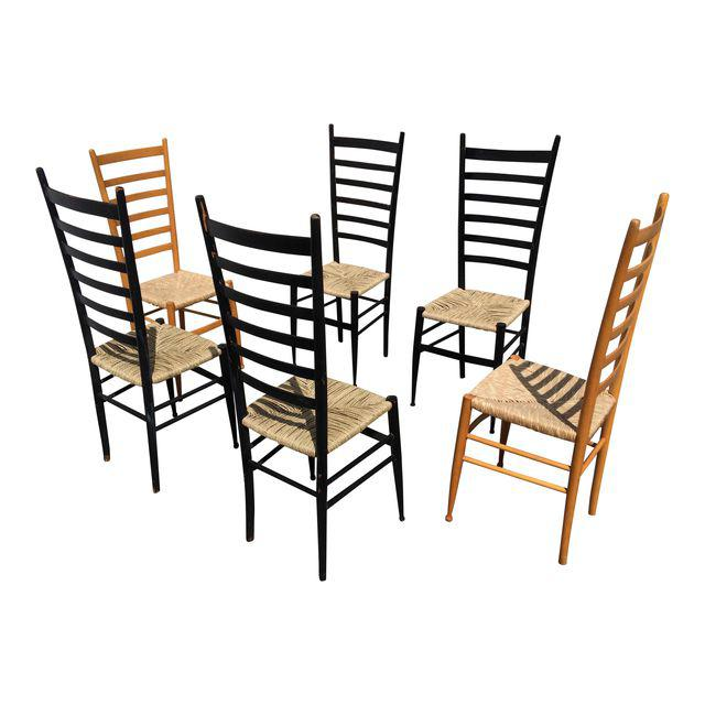 Amazing set of 6 Italian ladder back chairs, all new seats on the black chairs in sea grass. This was a fun and labor intensive repair job. I love the chairs! They look great with a blonde dining table I found, see the listing for pics! I would gladly make you a great deal if you purchase the entire set!
