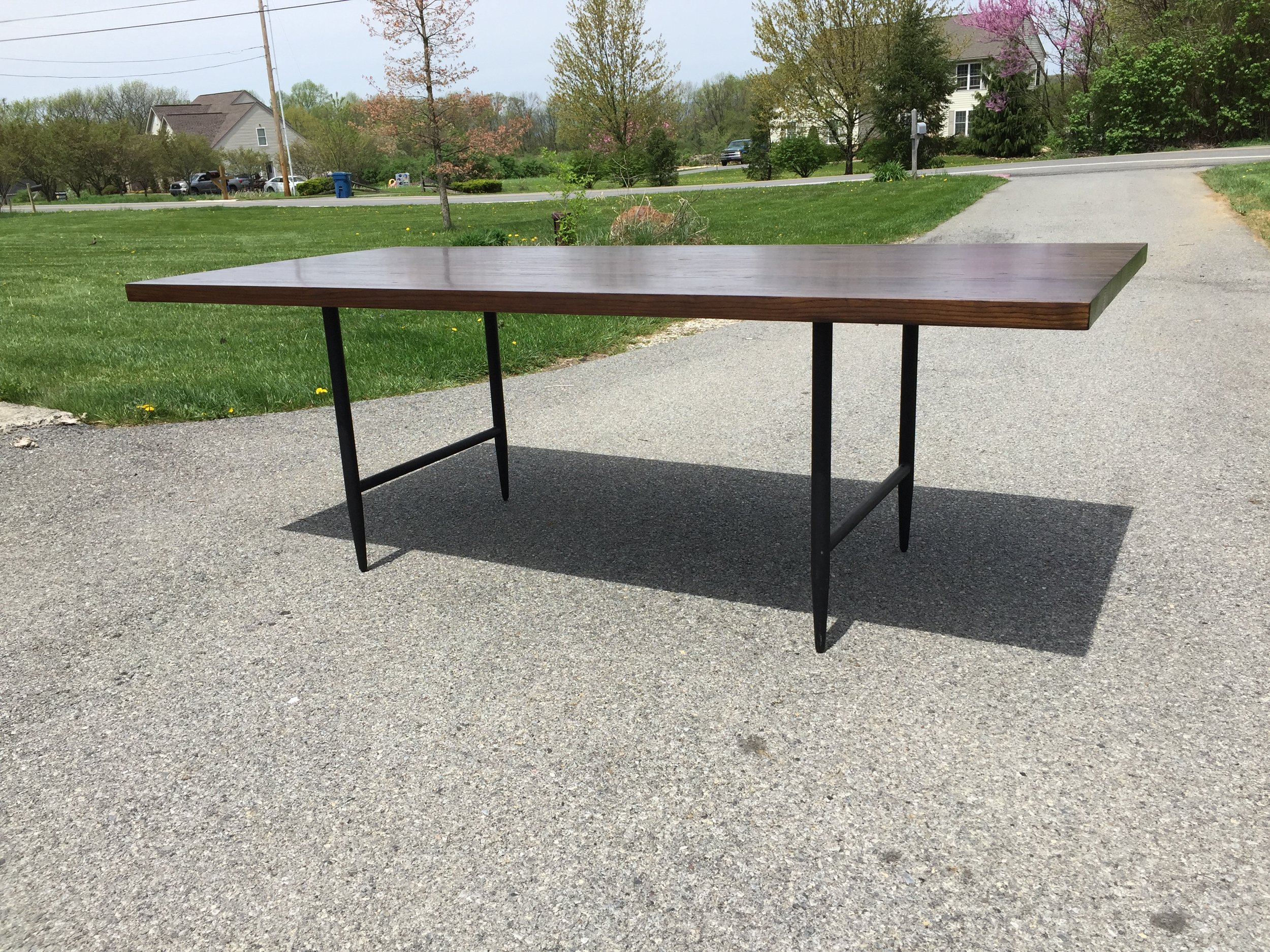 "Beautiful dining table by California Designer Maria Yee. Known for her solid wood, eco friendly and sustainable designs, her items are top notch.  This 88"" long table is beautiful and perfect for many decor styles. The matte black steel legs are sleek and lean."