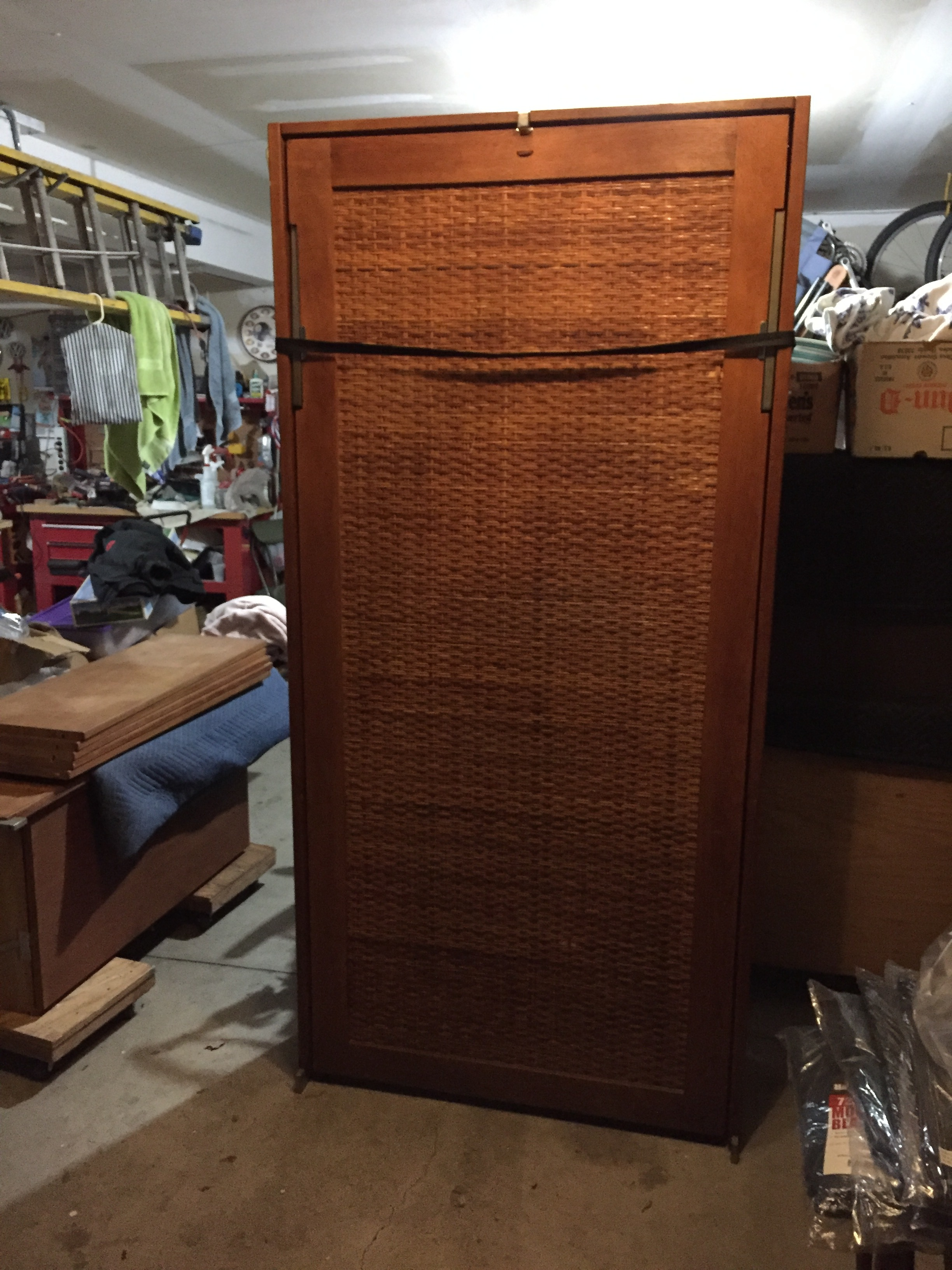 The closed bed features a beautiful rattan panel, leather grab loop which we are recreating, straps that will secure the mattress when lifting and a nice latch that holds it all in place. We will need to replace one of the straps and add a buckle.