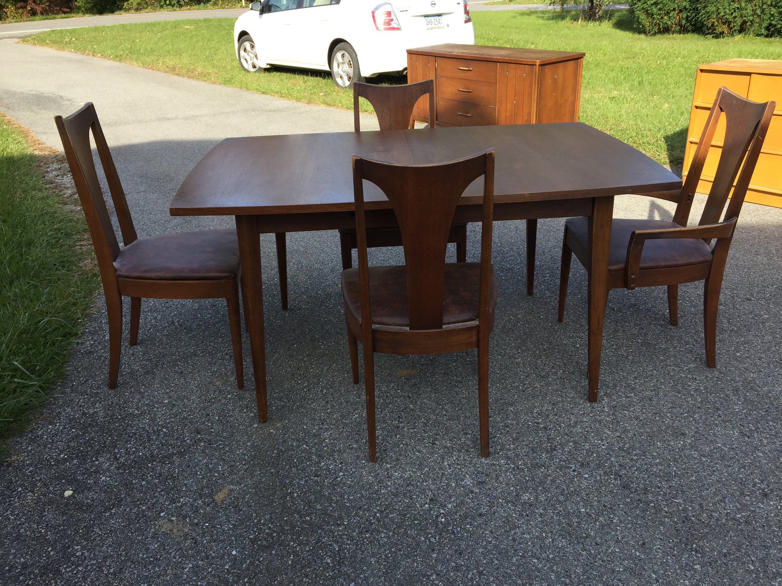 Broyhill Saga dining table with 3 side chairs, 1 arm chair plus 1 table leaf. Table top could use refinish, chairs too. Seats to be recovered. Beautiful set $500