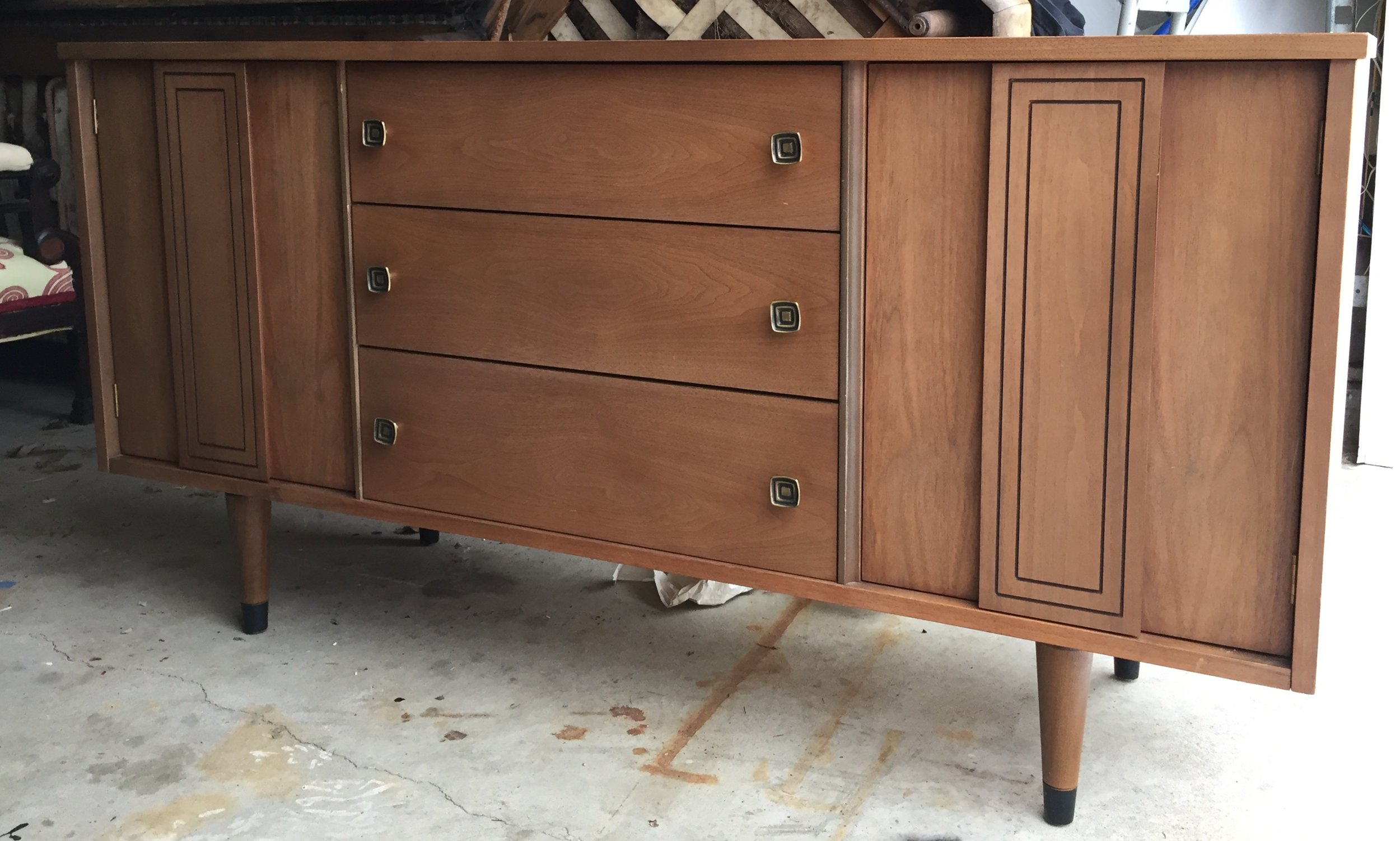The credenza. Beautiful condition! Lots of storage.