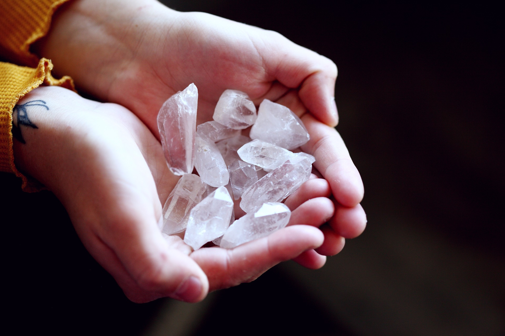raw quartz in hands