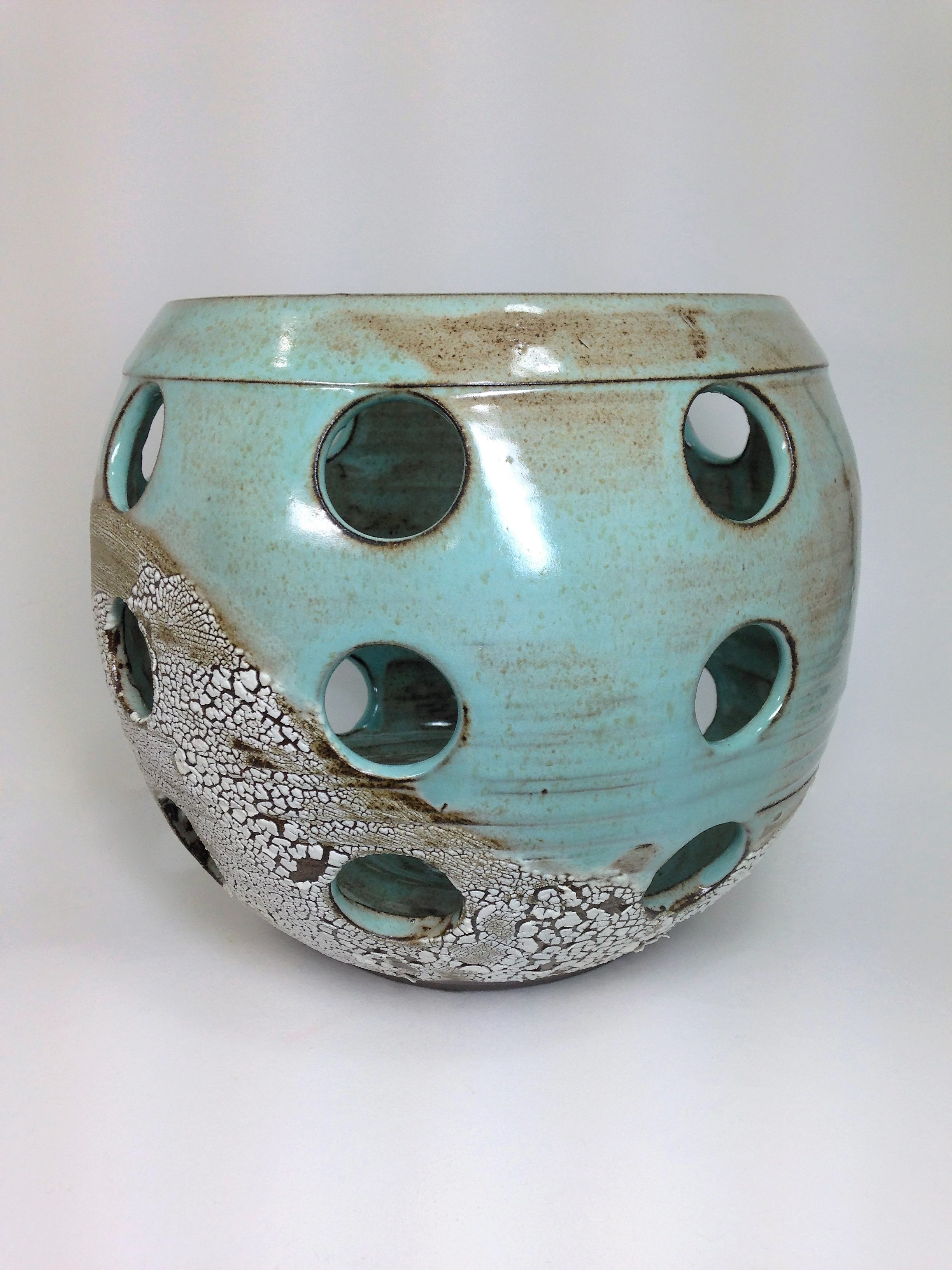 An example of an orchid pot with extra drainage holes