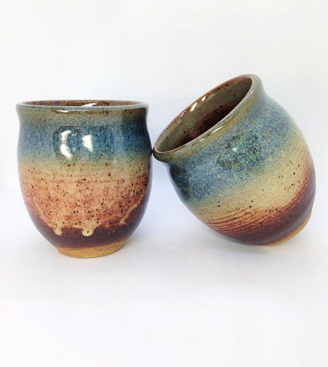 Fresh out of the kiln! I'm loving this color combination on the speckled clay. The only downside is that where the glaze is light on the bottom it has a textured feel to it. I plan on retrying a new set with more glaze on the bottom as well as burnishing them. Hopefully I will have a few soon that I can put in the shop!