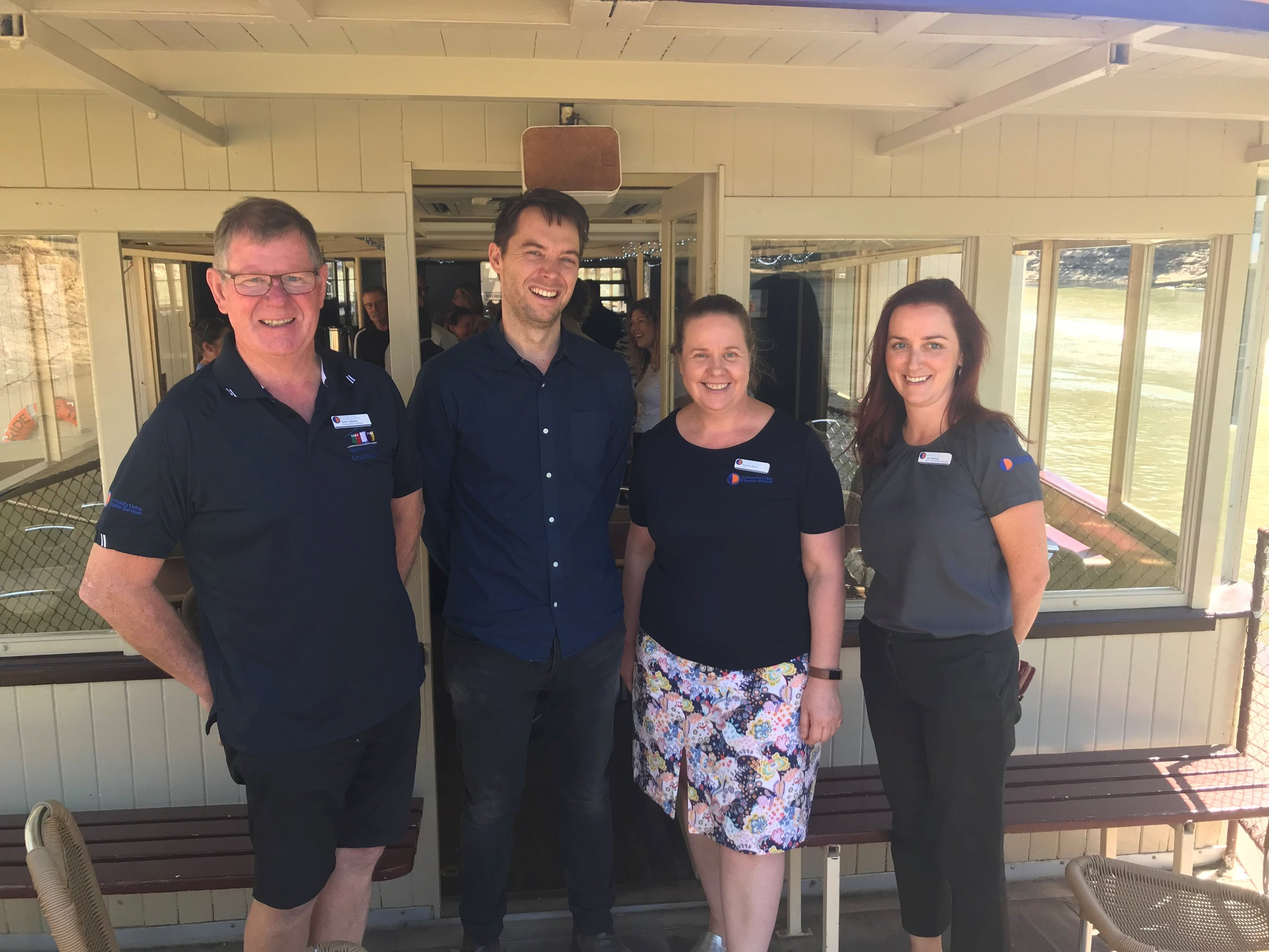 Fundraising Coordinator Dave Callanan, CEO Suzanna Barry and Service Development Manager Leah McNulty from Community Living & Respite Services with Riverboats Music Festival Director David Frazer