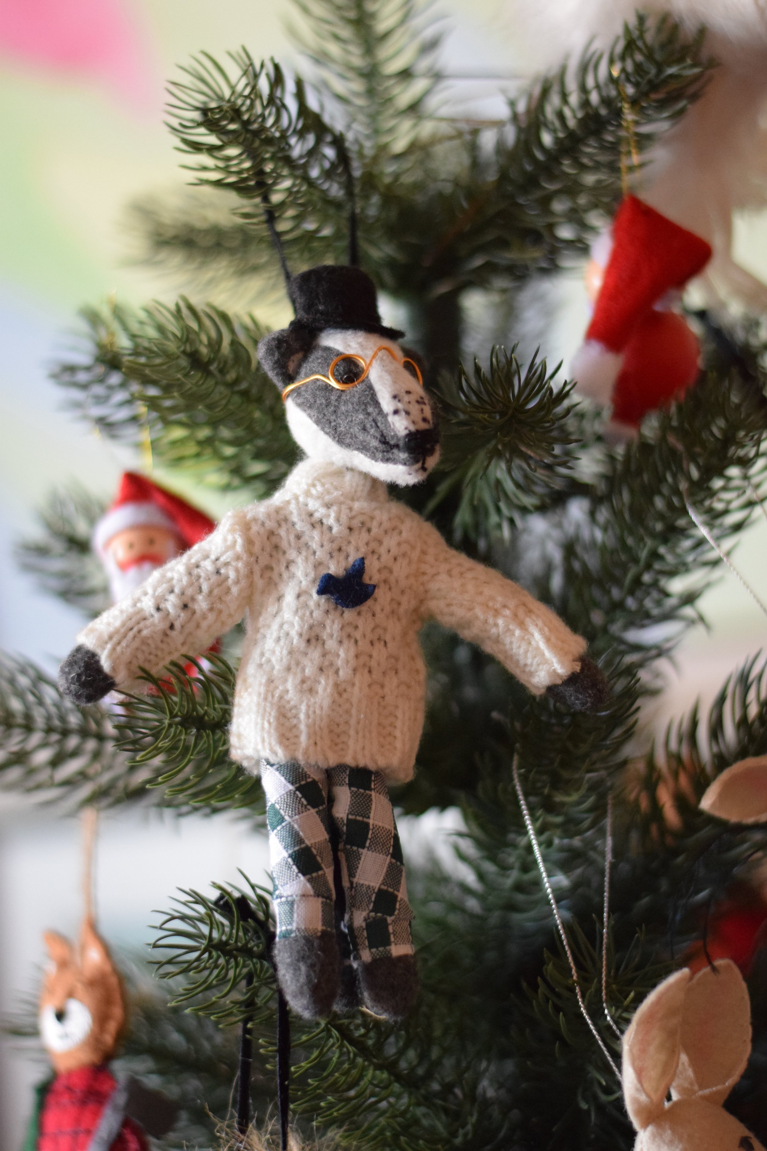 Whimsical badger wearing sweater ornament from Anthropologie.