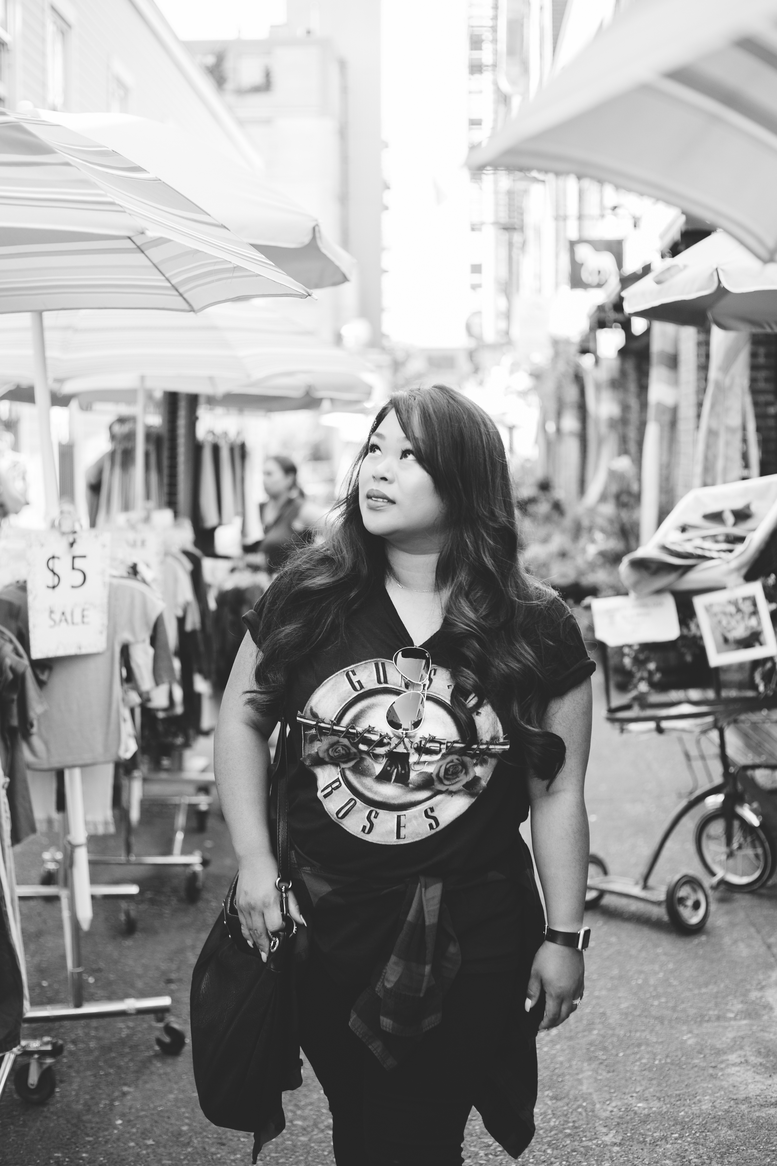 Classic black & white portrait amidst a crowded alleyway street vendor.