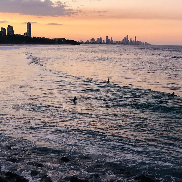 Waiting for just one more wave... and praying the sharks stay at bay. Burleigh magic at sunset. #sunsetsurf #surfing #surfer #surflineup #burleighbeach #goldcoast #australianlifestyle #coastalliving @goldcoast @burleigh_boardriders @burleightourism