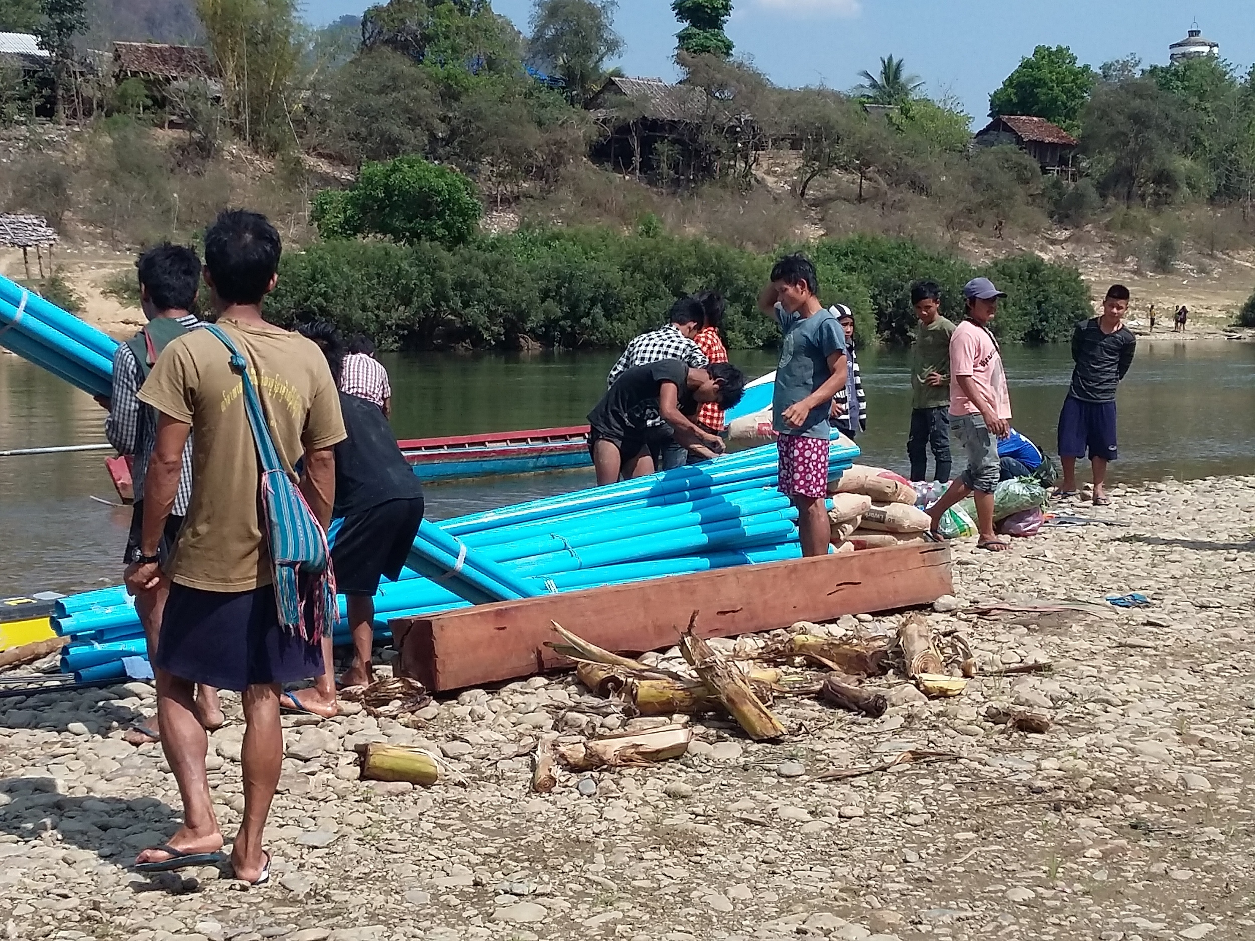 Villagers helping move material