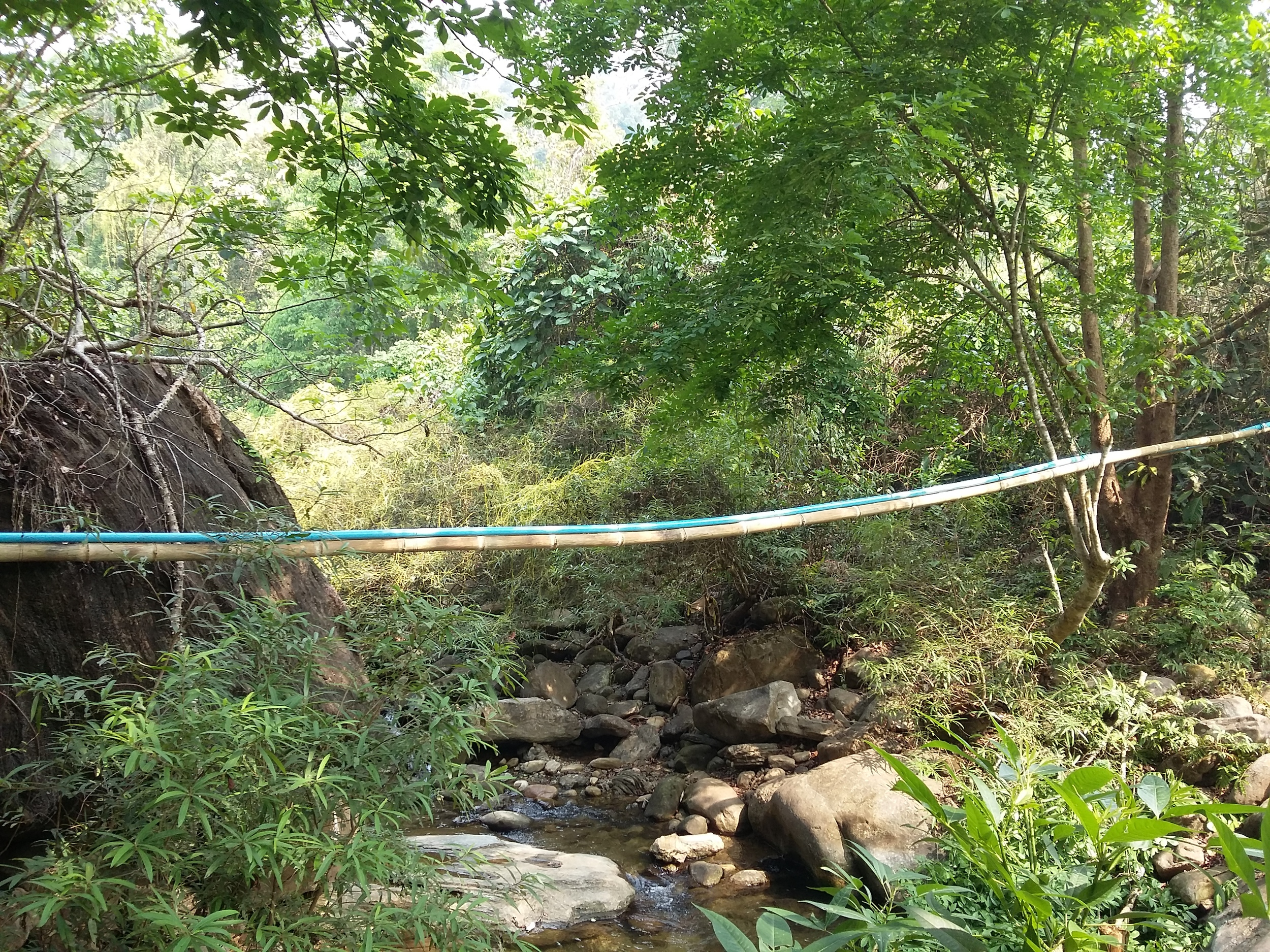PVC attached to Bamboo used to span a river