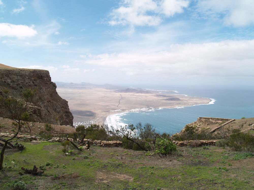 The Lanzarote  Beach Apartmen t is located in the centre of this picture close tothe stunning Famara bay, with Cliff and Island Vistas, ideal for a rural holiday or eco retreat