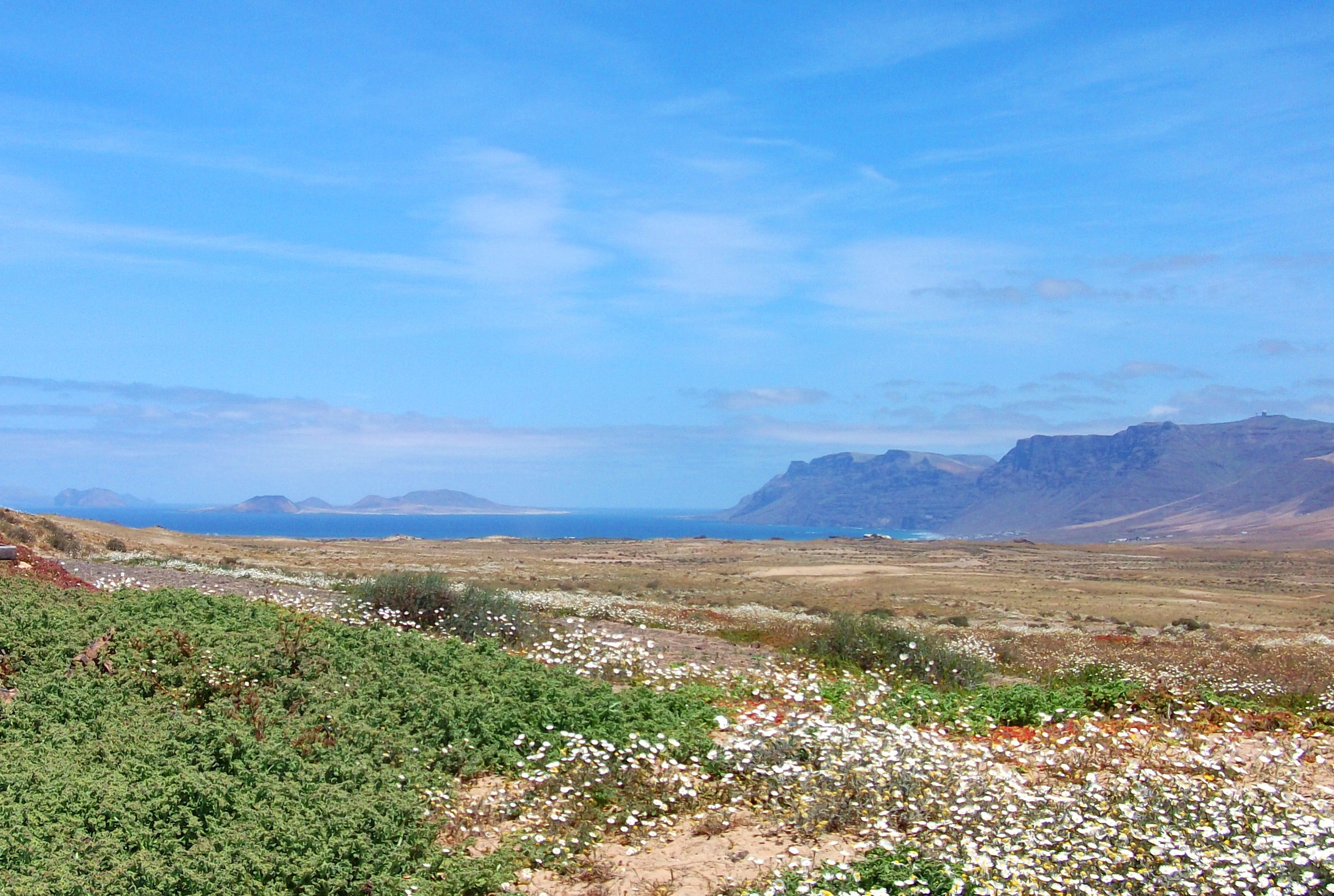This is the vast vista of natural park enjoyed by the eco cottage accommodation,  Jewel of the Sands , with La Graciosa island beyond. Click to inspect this totally restored Lanzarote Finca with its authentic Canarian interiors and relaxing gardens