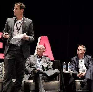 Younicos' Dean Tuel (center) and ATG Energy's Patrick Woodson listen as Skaia Energy's Ingmar Sterzing explains TREIA's 50% by 2030 plan. | ©  RTO Insider