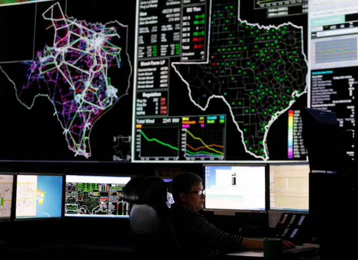 System operators work in the command center of the Electric Reliability Council of Texas in Taylor, Texas on Tuesday, May 15, 2018. About 90 percent of Texas' electric load is managed by ERCOT. (Vernon Bryant/Staff Photographer)