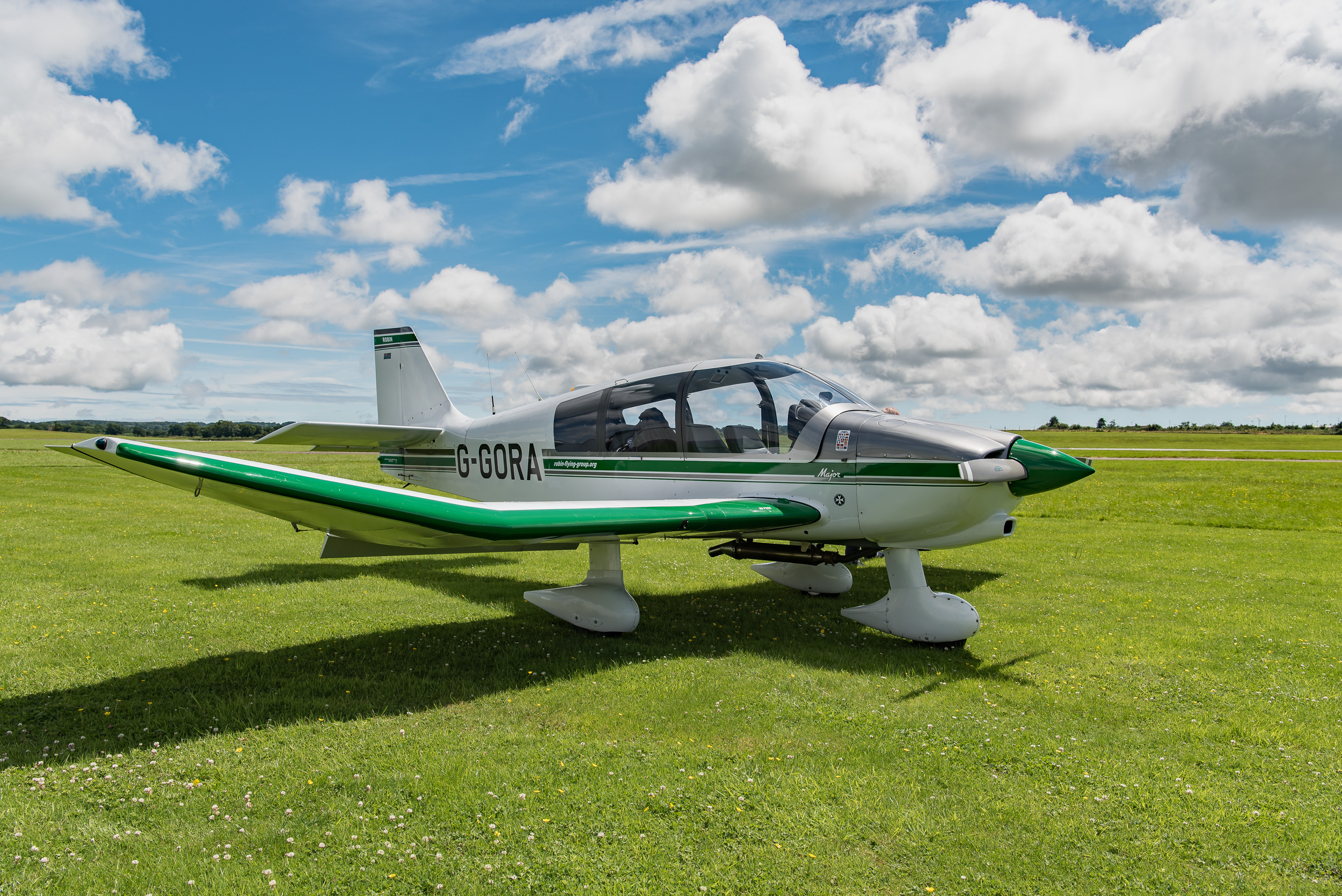 The Robin DR400, a wonderful aircraft to fly, but the low wings make photography challenging.