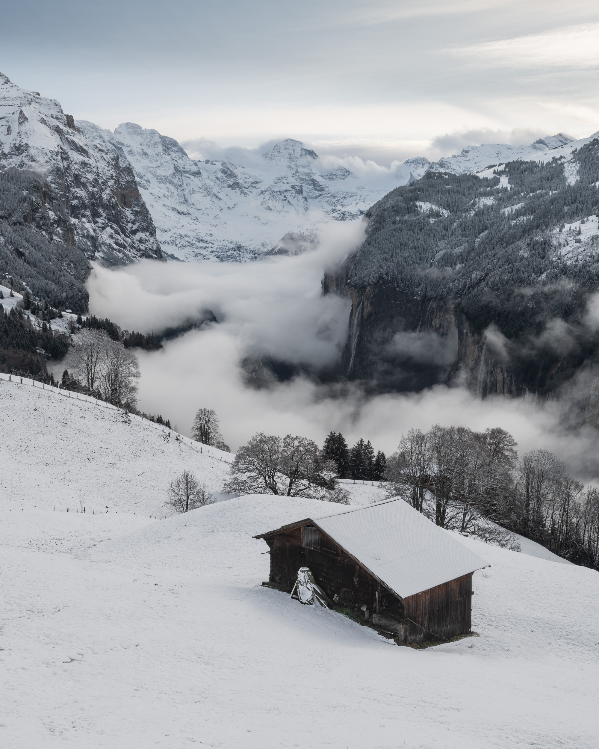 Cloud and Snow Along The Lauterbrunnen Valley, Wengen, Switzerland  - Nikon D850, Nikkor 16-35 mm f/4 VR at 35mm, f/13, 1/20th sec at ISO 64.