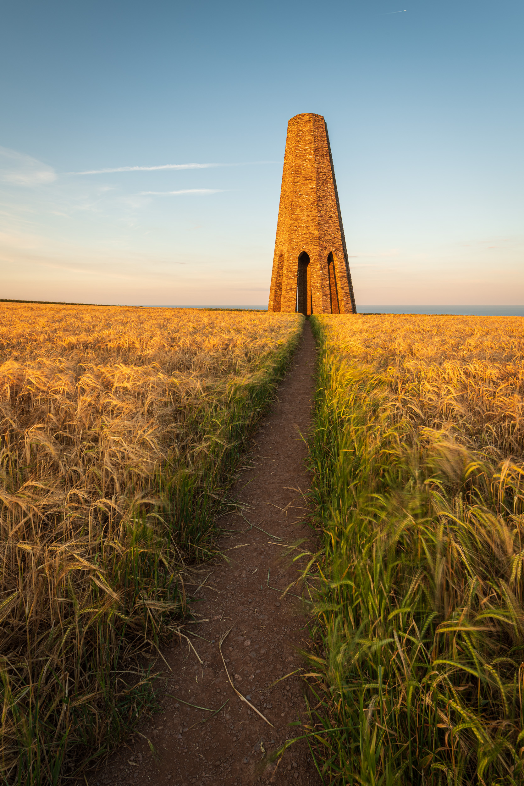 Field of Gold, Daymark Tower, Devon  - Nikon D850, Nikkor 16-35mm f/4 at 17mm, f/13, 1/3rd second at ISO 64.