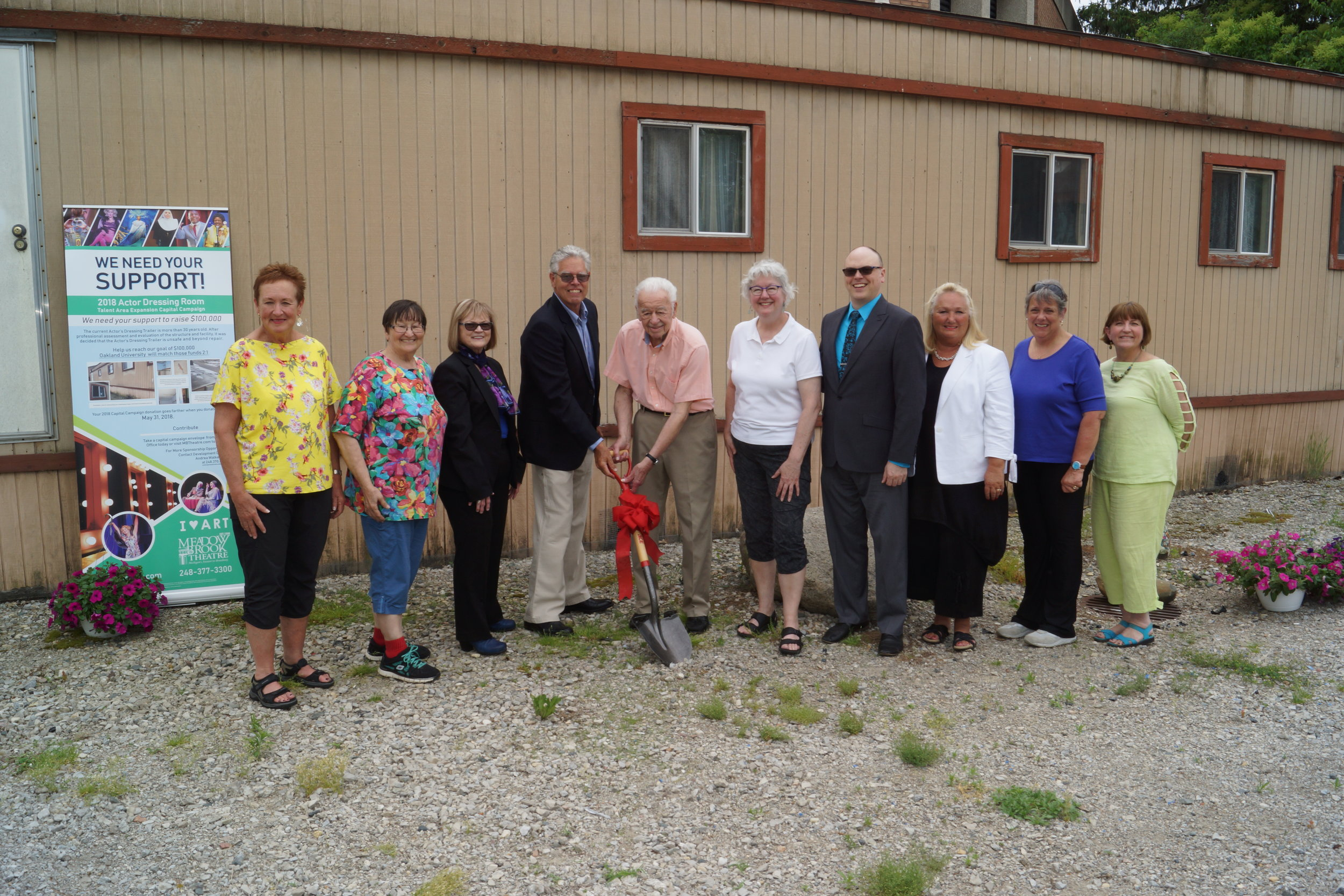 Notable MBT donors gather with staff to break ground on the construction of a new actors's dressing room.