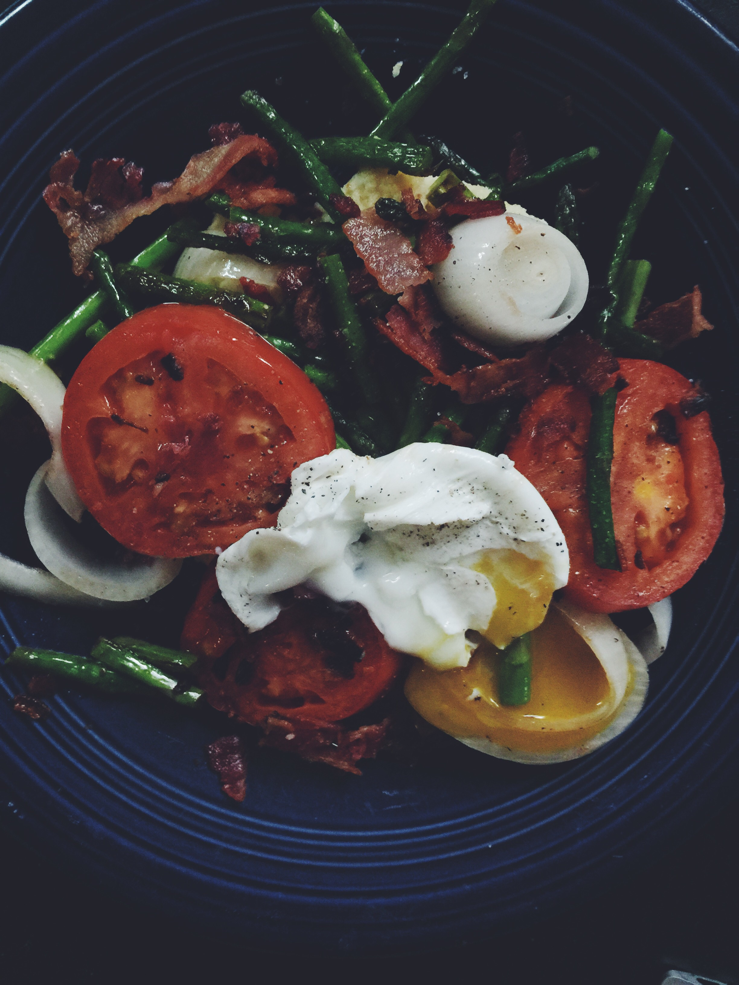 polenta with fried veggies and runny egg