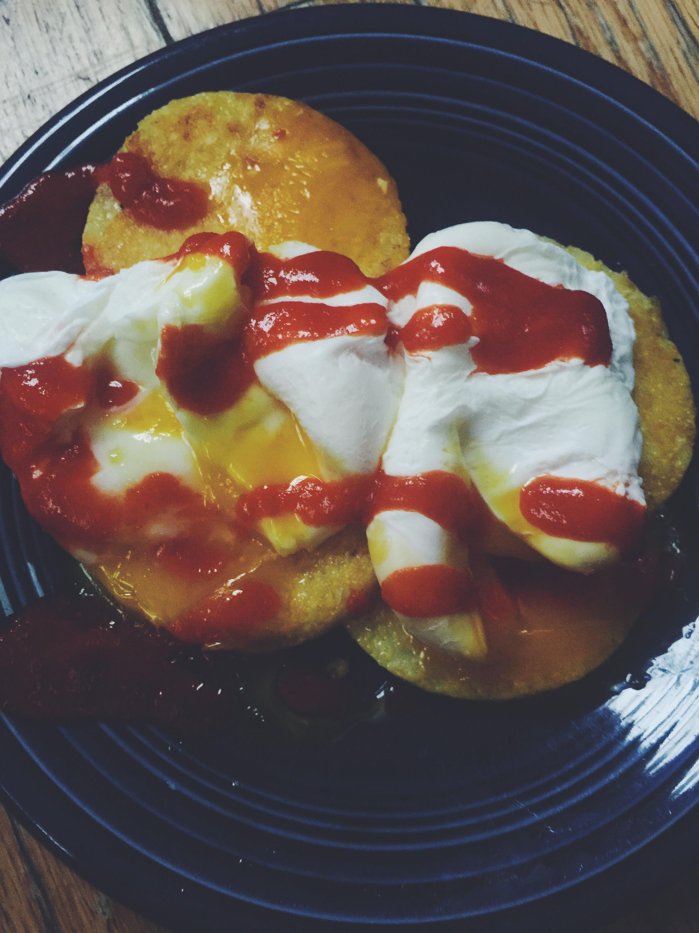 poached eggs + polenta + sriracha for breakfast