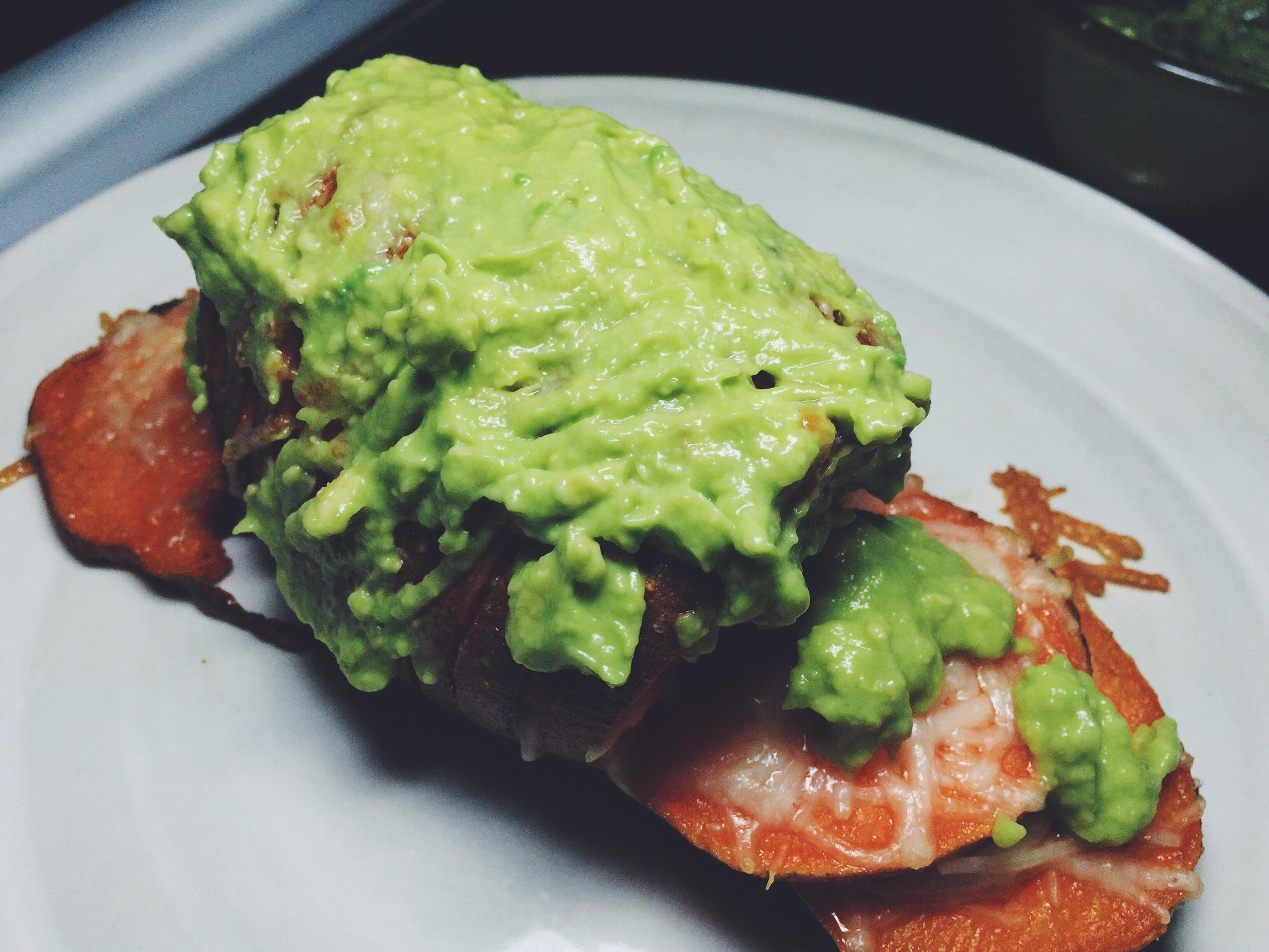 parmesan hasselback sweet potato with avocado cream